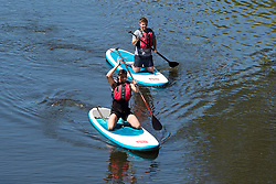 © Licensed to London News Pictures. 22/06/2019. Warwick, Warwickshire, UK. People paddle board along the river Avon  in Warwick during a hot summers day. Photo credit: LNP