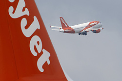 © Licensed to London News Pictures. 17/05/2021. Crawley, UK. A EasyJet aircraft takes off for Malaga, Spain from Gatwick Airport south of London as step three on the roadmap out of lockdown starts. Travel to 12 countries on the green list is allowed from today. Holiday-makers returning home from green listed countries, including Portugal, Gibraltar and Iceland will not have to self-isolate on return. Various hospitality rules are also changing today - with pubs and restaurants allowed to serve seated customers indoors. Photo credit: Peter Macdiarmid/LNP