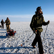 (Front to back): Misha, Nastya and Heleen trek across frozen Lake Baikal in Siberia, Russia. (Second day)..They are a group of five people: Justin Jin (Chinese-British), Heleen van Geest (Dutch), Nastya and Misha Martynov (Russian) and their Russian guide Arkady. .They pulled their sledges 80 km across the world's deepest lake, taking a break on Olkhon Island. They slept two nights on the ice in -15c. .Baikal, the world's largest lake by volume, contains one-fifth of the earth's fresh water and plunges to a depth of 1,637 metres..The lake is frozen from November to April, allowing people to cross by cars and lorries.