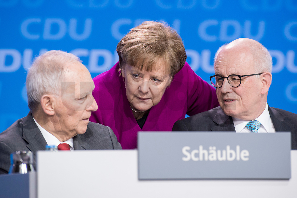 26 FEB 2018, BERLIN/GERMANY:<br /> Wolfgang Schaeuble (L), CDU, Praesident des Deutschen Bundestages, Angela Merkel (M), CDU, Bundeskanzlerin, und Volker Kauder (R), CDU, CDU/CSU Fraktionsvorsitzender, im Gespraech, CDU Bundesparteitag, Station Berlin<br /> IMAGE: 20180226-01-163<br /> KEYWORDS: Party Congress, Parteitag, Gespräch