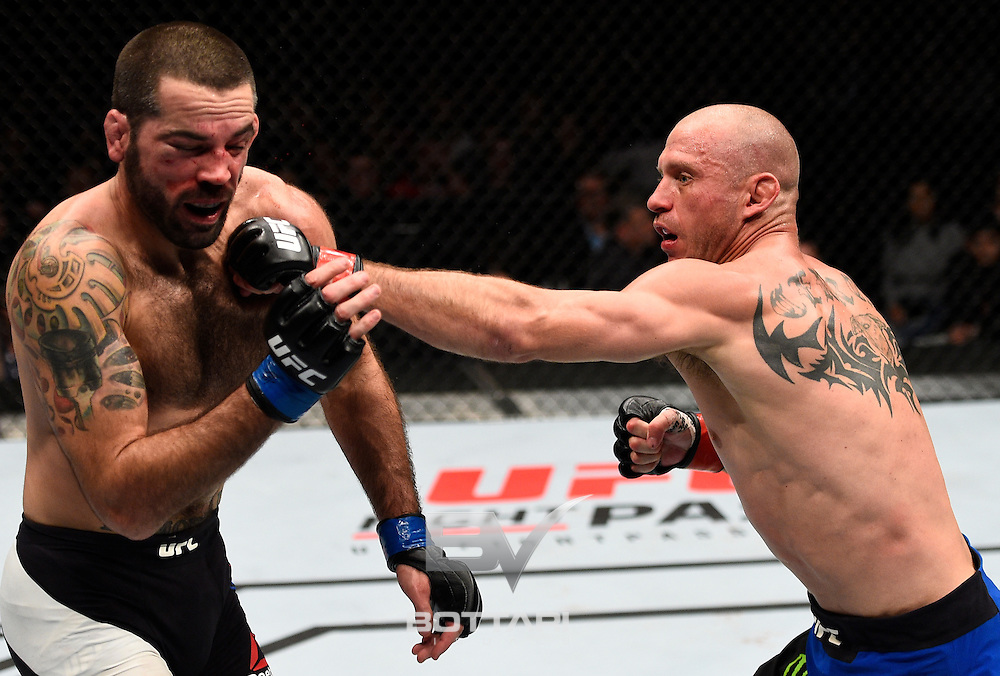 TORONTO, CANADA - DECEMBER 10:  (R-L) Donald Cerrone punches Matt Brown in their welterweight bout during the UFC 206 event inside the Air Canada Centre on December 10, 2016 in Toronto, Ontario, Canada. (Photo by Jeff Bottari/Zuffa LLC/Zuffa LLC via Getty Images)