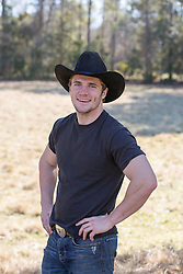 cowboy smiling on a ranch