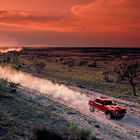 Lamborghini speeding across West Texas, helicopter aerial photograph.