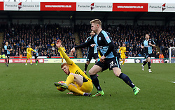 Rory Gaffney of Bristol Rovers controls the ball under pressure from Jason McCarthy of Wycombe Wanderers - Mandatory byline: Robbie Stephenson/JMP - 27/02/2016 - FOOTBALL - Adams Park - Wycombe, England - Wycombe Wanderers v Bristol Rovers - Sky Bet League Two