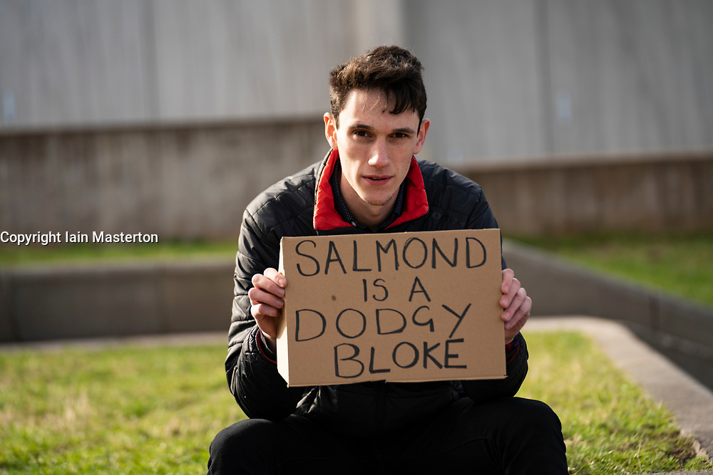 Edinburgh, Scotland, UK. 26 Feb 2021.  Alex Salmond  appears at committee on the Scottish government handling of harassment complaints today at Scottish Parliament in Holyrood. Pic; Man with protest sign outside Scottish Parliament today.  Edinburgh. Iain Masterton/Alamy Live News