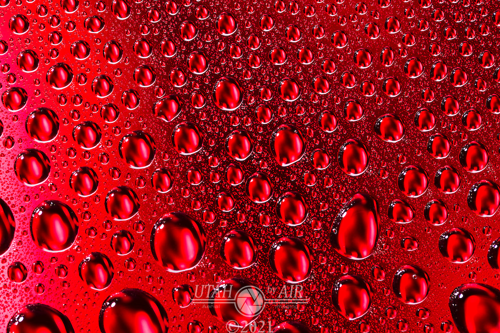 Water droplets over multi-colored backgrounds