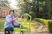 Senior Adult Women Restoring Chair in Backyard