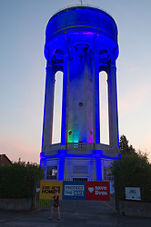To honour NHS and care workers water treatment firm APS in conjunction with Thames Water (owners) and Stanley Electronics lit up tower. Coronavirus lockdown, Tilehurst, Reading UK 2020