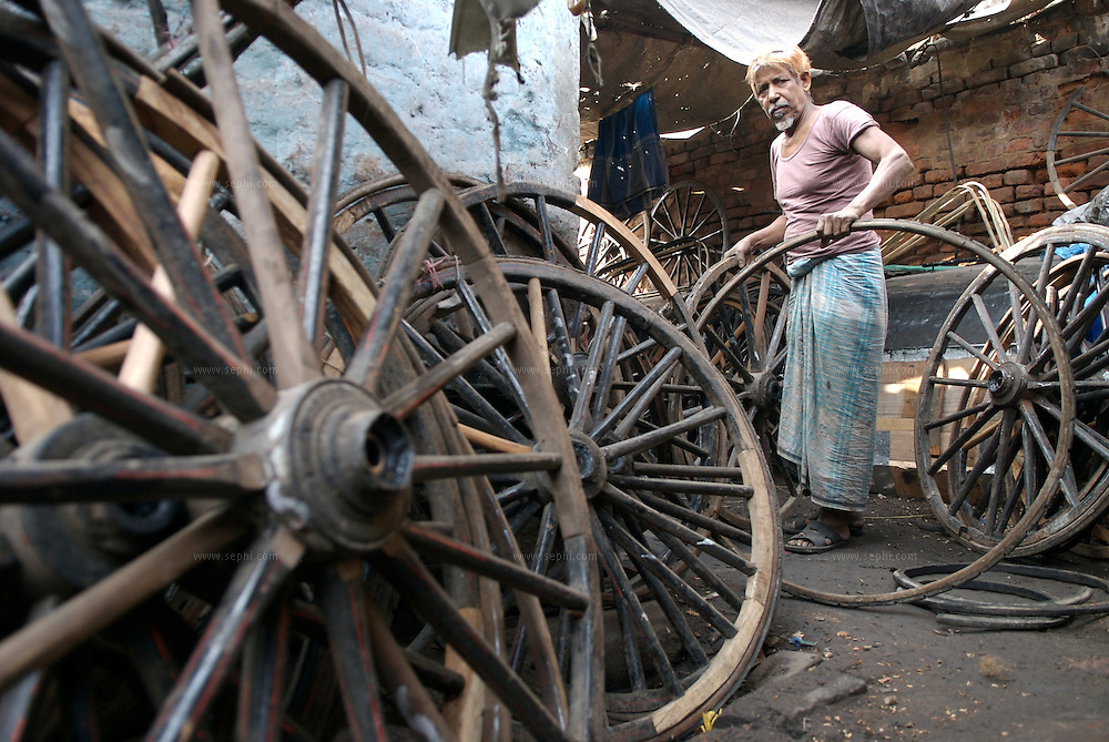 """The rickshaw mechanic at the dera...The hand-pulled rickshaw of Calcutta, immortalised by Dominic Lapierre's famous novel, City of Joy, will soon be a part of the history books as a bill passed by the West Bengal state assembly described the centuries-old mode of transport as """"inhumane."""".The future of about 18,000 rickshaw pullers in the city, earning an avarage daily wages of about 100 rupees ($2.5).is unclear as they call for a compensation package to help them rehabilitate into alternative jobs."""