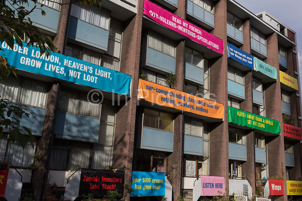 Banners on the balconies of homes in Bowater House on the Golden Lane Estate to protest about the 10-storey luxury apartment development called The Denizen, a controversial building by Taylor Wimpey that locals say will dominate their view and block their daylight, on 30th October 2017, in London, England. Residents on the Estate have erected banners by artists Jeremy Deller and Elizabeth Price to picket the developers. Despite this, Wimpey say, We are one of the UKs largest residential developers. As a responsible developer we are committed to working with local people and communities.