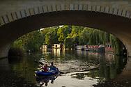 A couple is canoeing in the Landwehrkanal in Tiergarten, Berlin 2017.