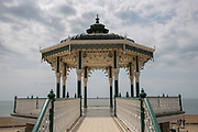 A decorative bandstand along the Brighton and Hove seafront on the 19th July 2018 in Brighton in the United Kingdom. The lower half of the bandstand is a cafe.
