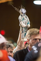 October 28, 2016 - Manchester, New Hampshire, U.S. - A supporter of Donald Trump, the republican candidate for president of the United States, holds up a Hillary Clinton voodoo doll during a campaign stop at the Armory Ballroom. (Credit Image: © Bryce Vickmark via ZUMA Wire)
