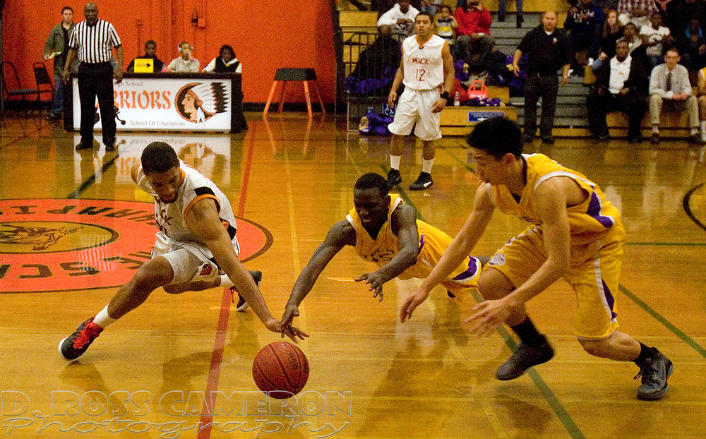 McClymonds High School's Lawrence Otis, from left, Oakland Technical High School's Leo Smith and teammate Benny Luong all converge on a loose ball during the fourth quarter of their Oakland Athletic League boys' basketball game, Wednesday, Feb. 1, 2012 in Oakland, Calif. McClymonds won, 58-55. (D. Ross Cameron/Staff)