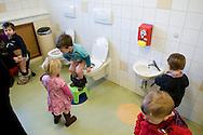"""Nederland, Herpen, 20090128...Kinderen gaan naar de wc. toilet. plasje doen...Kinderopvang 'Op de boerderij' in Herpen...""""OP DE BOERDERIJ"""" kinderopvang..is gevestigd bij een vleesveebedrijf te Herpen.....Netherlands, Herpen, 20090128. ..Children go to the bathroom. toilet...Childcare on the farm in Herpen. ..""""ON THE FARM"""" childcare ..is located at a beef farm in Herpen."""