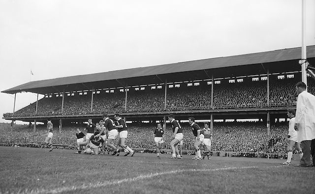 A group of players huddle in a tackle for the ball during the All Ireland Senior Gaelic Football Championship Final, Kerry vs Galway in Croke Park on the 27th September 1964. Galway 0-15 Kerry 0-10.