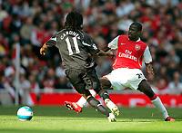 Photo: Tom Dulat.<br /> Arsenal v Bolton Wanderers. The FA Barclays Premiership. 20/10/2007.<br /> Ricardo Gardner of Bolton Wanderers and Emmanuel Eboue of Arsenal with the ball.