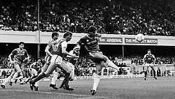 Leicester City's Alan Smith clears the ball after another attack during the First Division match at Highbury. Arsenal's Tommy Caton (second left) sets off in pursuit.