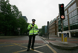UK ENGLAND LONDON 7JUL05 - A policeman guards the cordoned-off Euston Road leading to Kings Cross, the site of a major bomb attack in central London. At least two people have been killed and scores have been injured after at least seven blasts on the Underground network and a double-decker bus in London...jre/Photo by Jiri Rezac ..© Jiri Rezac 2005..Contact: +44 (0) 7050 110 417.Mobile:  +44 (0) 7801 337 683.Office:  +44 (0) 20 8968 9635..Email:   jiri@jirirezac.com.Web:    www.jirirezac.com..© All images Jiri Rezac 2005 - All rights reserved.