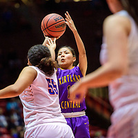Kirtland Central Bronco Melanie Yazzie (11) attempts a three-point basket ahead of Los Lunas Tiger Maya Trujillo (55) in a District 5A semifinal at The Pit in Albuquerque Thursday.