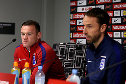 England interim manager Gareth Southgate and a sombre looking Wayne Rooney of England take questions during the Press Conference ahead of the World Cup Qualifier against Slovenia - Mandatory by-line: Robbie Stephenson/JMP - 10/10/2016 - FOOTBALL - SRC Stozice - Ljubljana, England - England Press Conference