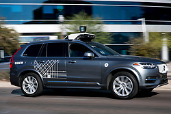 An Uber self-driving autonomous vehicle seen driving in Tempe, Arizona on February 3, 2018. Tempe has become a hotbed of self-driving vehicle testing as the city has welcomed companies developing the technology to its roads. (Photo by Kristoffer Tripplaar/Sipa USA)