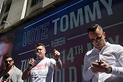 London, UK. 14 May, 2019. Former English Defence League leader Tommy Robinson addresses his supporters outside the Old Bailey before his hearing before two High Court judges for an allegation of contempt of court.