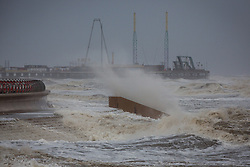 "© Licensed to London News Pictures . 10/12/2014 . Blackpool , UK . Waves crash on to the seafront . An explosive cyclogenesis - a fast developing storm in which air pressure falls rapidly - known as a "" weather bomb "" - hits the North of England , bringing storms to the region . Photo credit : Joel Goodman/LNP"