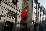 The Chinese national flag hanging in sunshine from the Bank of China's headquarters, on 13th February 2017, in the City of London, United Kingdom.