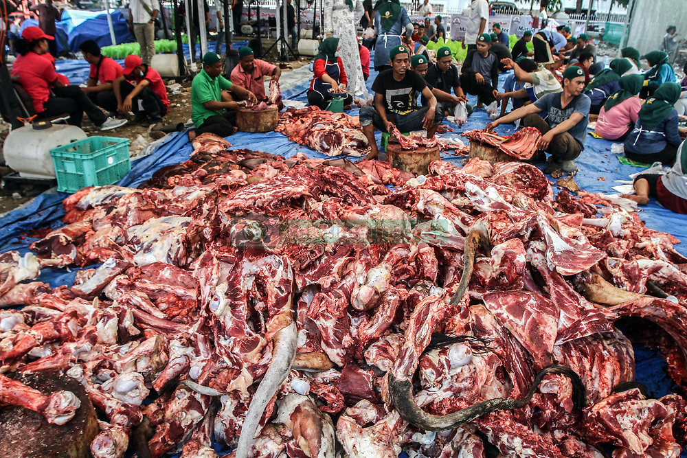 September 1, 2017 - Medan, North Sumatra, Indonesia - Indonesian Muslims slaughter the beef that is distributed to the poor during Eid al-Adha celebrations outside the Mosque on September 1, 2017 in Medan, Indonesia. Muslims in Indonesia celebrate Eid al-Adha, the ''Feast of Sacrifice'', which marks the end of an annual pilgrimage or pilgrimage to the Saudi holy city of Mecca and remembers Abraham's readiness to sacrifice his son to God. (Credit Image: © Ivan Damanik via ZUMA Wire)