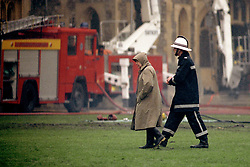 File photo dated 21/11/92 of Queen Elizabeth II surveying the scene at Windsor Castle following the fire, as the Private Chapel, where Archie Mountbatten-Windsor will be christened, had to be entirely rebuilt following the devastating Windsor Castle fire in 1992.