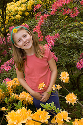 United States, Washington, Seattle, girl (age 9) among azaleas in Washington Park Arboretum.  MR