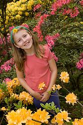 United States, Washington, Seattle, girl (age 9) among azaleas in Washington Park Arboretum.  MR
