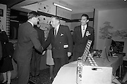 22/10/1963<br /> 10/22/1963<br /> 22 October 1963<br /> R.D.S. Scientific Exhibition opens, Ballsbridge, Dublin. Queen's University Belfast Chemistry stand at the exhibition. Taoiseach Sean Lemass (centre) is greeted by  Mr. Colm Graham,  Research Chemist at Queen's and Dr Salah Shahine (Egypt) Research Chemist at Queen's on right.