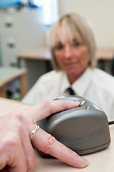 Electronic finger scan, HMP Bronzefield, women's prison in Surrey