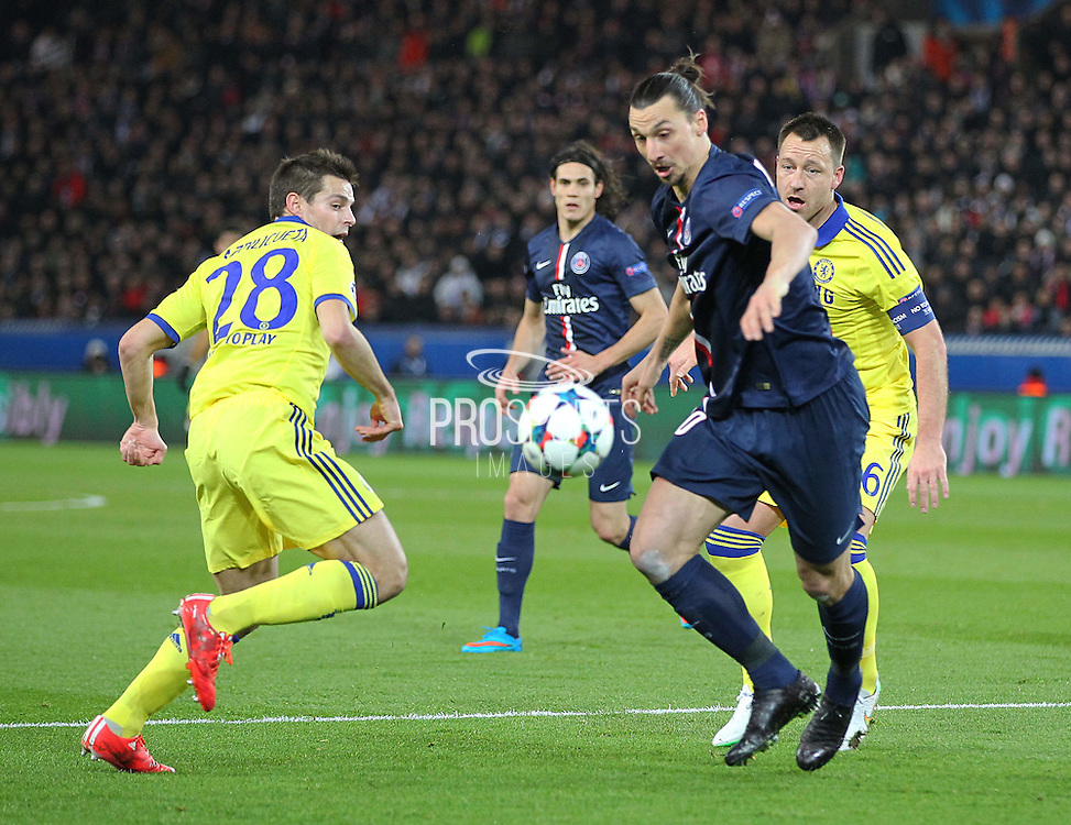 Paris Saint-Germain Zlatan Ibrahimović (vice captain) battling with Chelsea's César Azpilicueta during the Champions League match between Paris Saint-Germain and Chelsea at Parc des Princes, Paris, France on 17 February 2015. Photo by Phil Duncan.