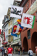 In Appenzell village, the red Rathaus (built 1560-83) houses the city hall, Appenzell Museum (attached yellow building), tourist office and library, on Hauptgasse (Main Street), in Switzerland, Europe. The Rathaus facade mural was painted by August Schmid from Diessenhofen (1928). Appenzell Museum shows a cross section of the Swiss Canton's history and culture (1400s flags and banners, embroidery, folk art, and even historic torture instruments). Appenzell village is in Appenzell Innerrhoden, Switzerland's most traditional and smallest-population canton (second smallest by area).
