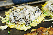 """Making """"Kakioko"""" oyster okonomiyaki pancakes. Bizen city, Okayama Prefecture, Japan, February 2, 2014. The city of Bizen in central Japan is famous for Bizen-ware pottery. It is also one of Japan's main traditional sword making regions, home to Osafune sword-makers and polishers."""