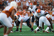 AUSTIN, TX - SEPTEMBER 26:  J.W. Walsh #4 of the Oklahoma State Cowboys calls a play at the line of scrimmage against the Texas Longhorns on September 26, 2015 at Darrell K Royal-Texas Memorial Stadium in Austin, Texas.  (Photo by Cooper Neill/Getty Images) *** Local Caption *** J.W. Walsh