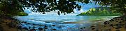 Panoramic mural view of Kahana Bay framed by trees on the windward coast of Oahu, Hawaii