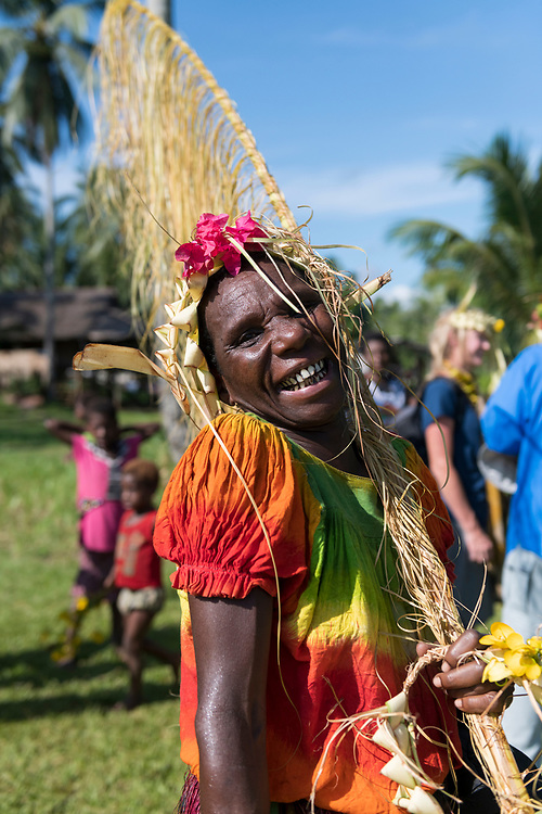 Engoi, a resident of Likan, a village on the Clay River in Papua New Guinea's East Sepik Province, welcomes arriving guests at the airstrip.<br /> <br /> (June 20, 2019)