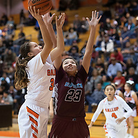 Gallup's Jordan Joe (34) takes a shot in the paint while Shiprock's Aaryanna Lansing (23) defends in their matchup Friday night at Gallup High School.