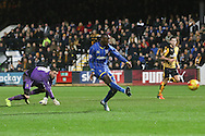 Ade Azeez of AFC Wimbledon rounds Sam Beasant (goalkeeper) of Cambridge United and and completes the rout during the Sky Bet League 2 match between Cambridge United and AFC Wimbledon at the R Costings Abbey Stadium, Cambridge, England on 2 January 2016. Photo by Stuart Butcher.