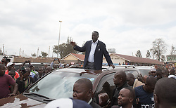 Aug. 8, 2017 - Nairobi, Kenya - RAILA ODINGA, Kenya's National Super Alliance (NASA) presidential candidate, waves to his supporters after casting his ballot at a polling station in Nairobi, capital of Kenya. About 19.6 million Kenyans are flocking to more than 40,000 polling stations across the nation to cast ballots for the election of the country's next president on Tuesday. (Credit Image: © Li Baishun/Xinhua via ZUMA Wire)