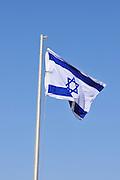 Israeli Flag on blue sky background