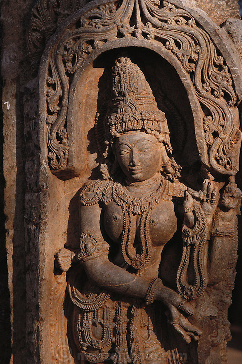 Carving on the temple wall at Halebid, South India. The ancient capital of the Hoysalas, Halebid was then known as Dwarasamudram. The great city of Dwarasamudra flourished as a Capital of the Hoysala Empire during the 12th & 13th centuries.
