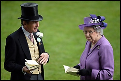 The Queen talks to her racing manager John Warren in the parade ring. After her horse Estimate wins the Gold Cup at Royal Ascot 2013 Ascot, United Kingdom,<br /> Thursday, 20th June 2013<br /> Picture by Andrew Parsons / i-Images