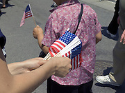 distributing small American flags during Fleet week 2005 NYC