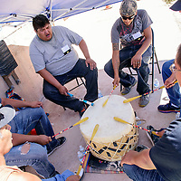 The Midnight Thunder group beats the drum during the Zuni Housing Authority Fair in Zuni Friday.