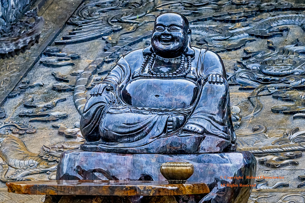 Bái Đính Buddha: This large carved Buddha is found out front of the Bái Đính Temple, a Cultural complex of Buddhist temples on Bai Dinh Mountain, Ninh Bình Vietnam.
